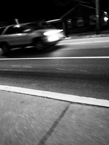 car suv passing motion blur line lights dark night nighttime black and white